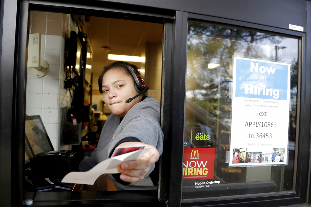 AP photo: A cashier returns a credit card and a receipt at a McDonald's window, where signage for job openings are displayed in Atlantic Highlands, N.J last month.
