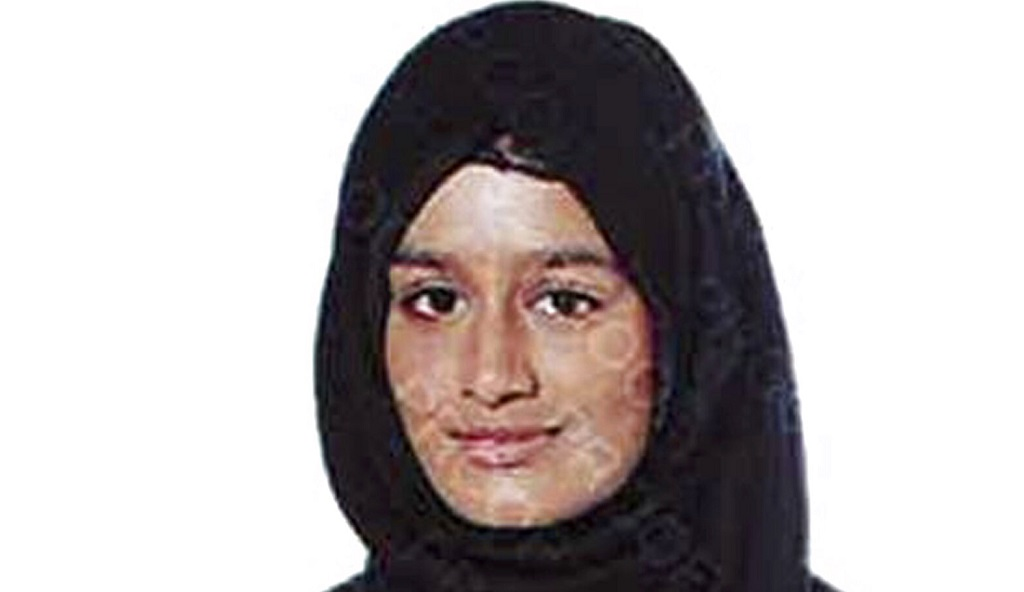 This undated photo issued by the Metropolitan Police shows Shamima Begum, a pregnant British teenager who ran away from Britain to join Islamic State extremists in Syria four years ago, who has said she wants to come back to London, but her path home is not clear. Begum told The Times newspaper in a story published Thursday Feb. 14, 2019, that she wants to come back to London. (Metropolitan Police via AP)