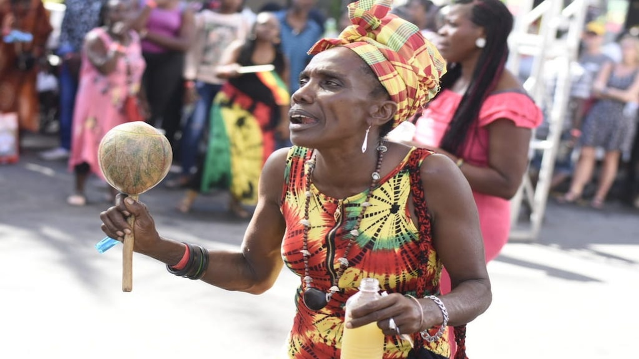 A woman with a calabash enjoying the vibes at Bob Marley 74th birthday activities at the Bob Marley Museum in Jamaica on Wednesday. (PHOTOS: Marlon Reid)