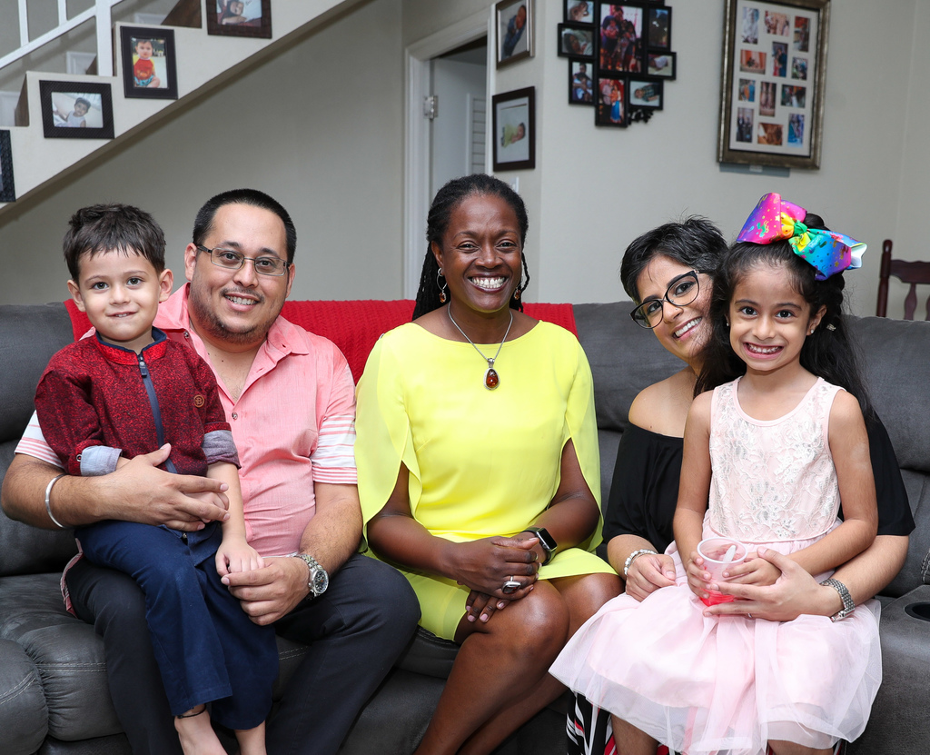 Sagicor Bank CEO Chorvelle Johnson (centre) celebrates with the Hotchandanis in their new home; (from left) are Rakesh and son Samir, his wife Sasha and their daughter Samaya.