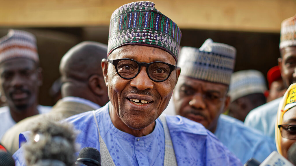 In this Saturday, Feb. 23, 2019 file photo, Nigeria's President Muhammadu Buhari speaks to the media after casting his vote in his hometown of Daura, in northern Nigeria. (AP Photo/Ben Curtis, File)