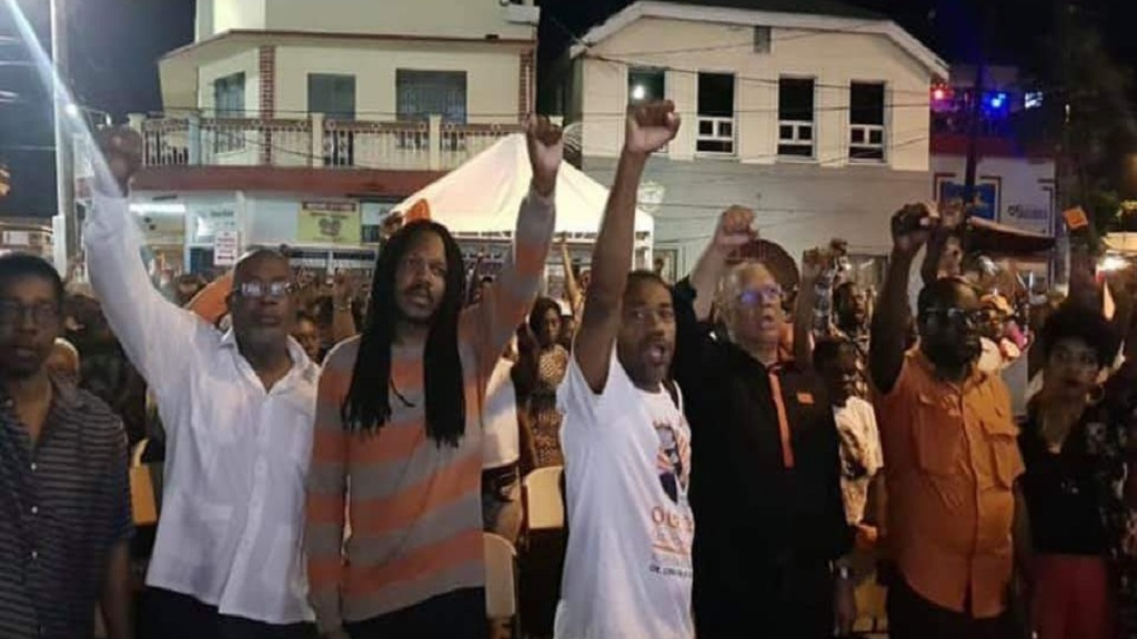 PNP President, Dr Peter Phillips (third right); PNP Chairman, Fitz Jackson (second left); and PNP Vice President, Damion Crawford (third left), at Saturday night's vigil in Port Antonio for slain Member of Parliament (MP), Dr Lynvale Bloomfield.