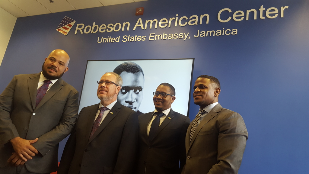 From left to right: Councillor of the Mona Division, Andrew Bellamy; Acting Charge d'Affaires of the American Embassy, Mark Seibel; State Minister in the Ministry of industry and Commerce, Floyd Green and Jeremiah Knight, Counselor for Public Affairs at the US Embassy at the  Paul Robeson American Center. (Photo: Marlon Reid)