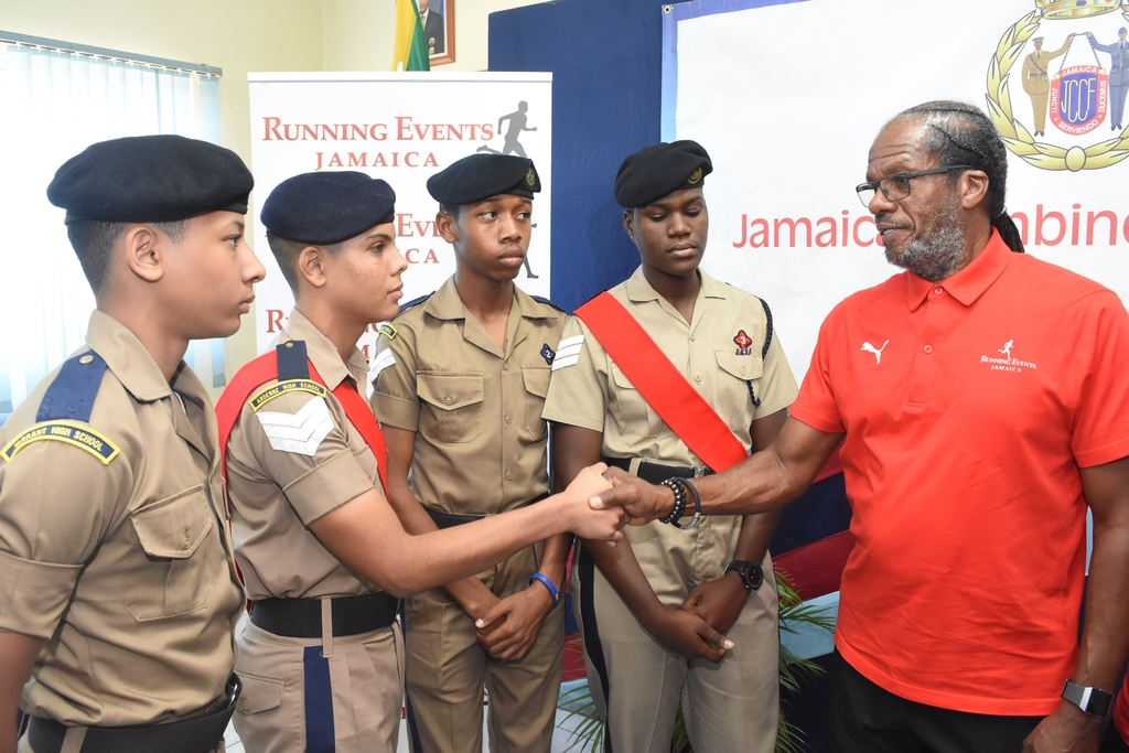 "Alfred ""Frano"" Francis (right), managing director of Running Events Jamaica shakes hands with Sergeant Nathanael Scarlett from the Jamaica Combined Cadet Force (JCCF) following the presentation of a cheque valued at $200,000 to the JCCF on Tuesday."