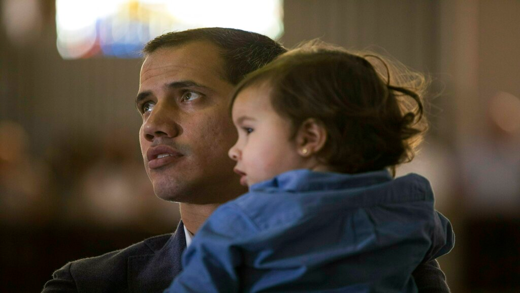 Opposition National Assembly President Juan Guaido, who declared himself interim president of Venezuela, holds his daughter Miranda while attending a Mass in a church in Caracas, Venezuela, Sunday, Feb. 10, 2019. (AP Photo/Rodrigo Abd)