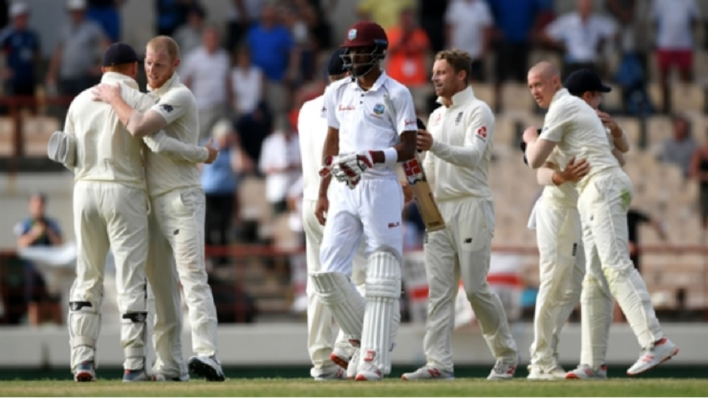 Roston Chase walks off unbeaten as England celebrate beating the Windies.