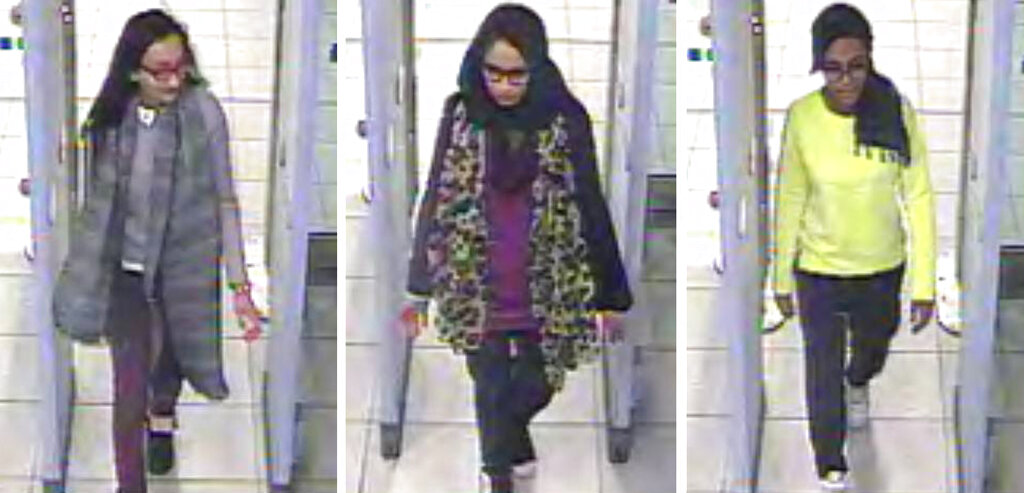 FILE - This Monday Feb. 23, 2015 file handout image of a three image combo of stills taken from CCTV issued by the Metropolitan Police shows Kadiza Sultana, left, Shamima Begum, center, and Amira Abase going through security at Gatwick airport, south England, before catching their flight to Turkey. (Metropolitan Police via AP)