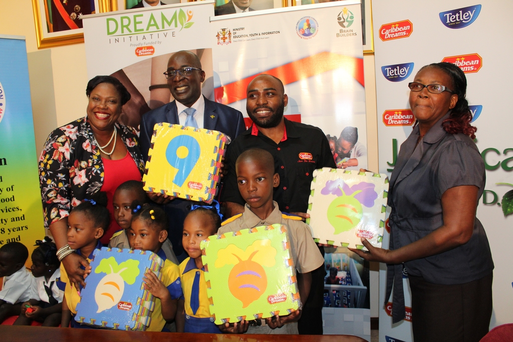 From left) Community Relations Manager at the Early Childhood Commission (ECC) Tanisha Miller, Minister of Education Senator the Honourable Ruel Reid, Marketing Manager at Jamaican Teas Charles Barrett, Practitioner at Regent Street Seventh Day Adventist Basic School and children from the institution pose for photo following the handing over ceremony.