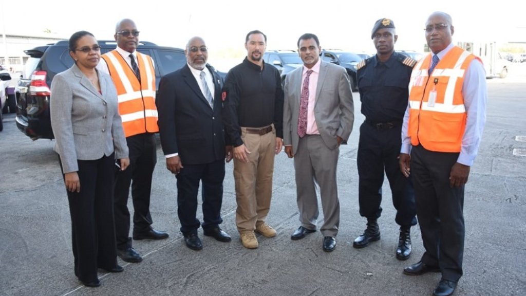 National Security Minister Stuart Young (left), Transport Minister Rohan Sinanan (right) tour Piarco International Airport