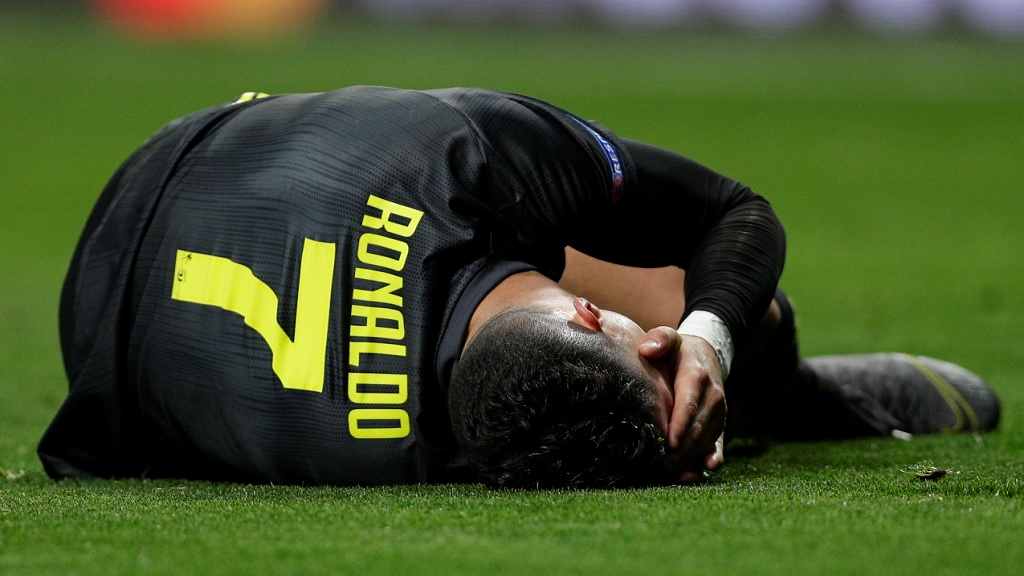Juventus forward Cristiano Ronaldo lies on the ground during the Champions League round of 16 first leg football match against Atletico Madrid at te Wanda Metropolitano stadium in Madrid, Wednesday, Feb. 20, 2019.