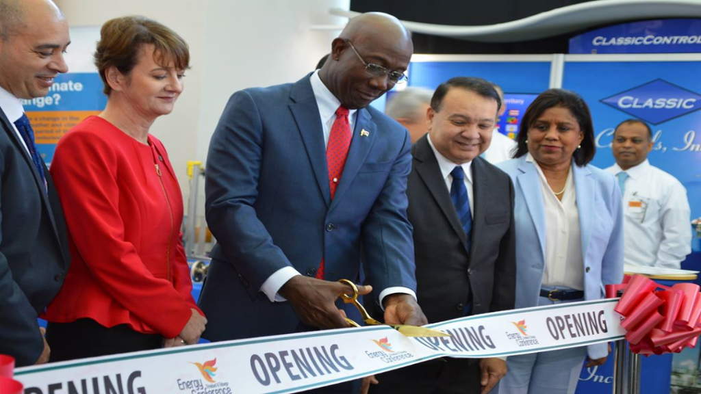 Prime Minister Dr Keith Rowley cuts the ribbon officially opening the tradeshow at the Trinidad and Tobago Energy Conference 2019, hosted by the Energy Chamber of Trinidad and Tobago. Photo courtesy the Office of the Prime Minister.