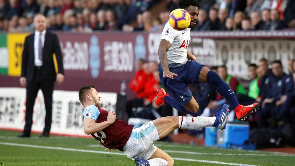 Burnley's Phillip Bardsley, left, challenges Tottenham Hotspur's Danny Rose during their English Premier League football match at Turf Moor in Burnley, England, Saturday Feb. 23, 2019.