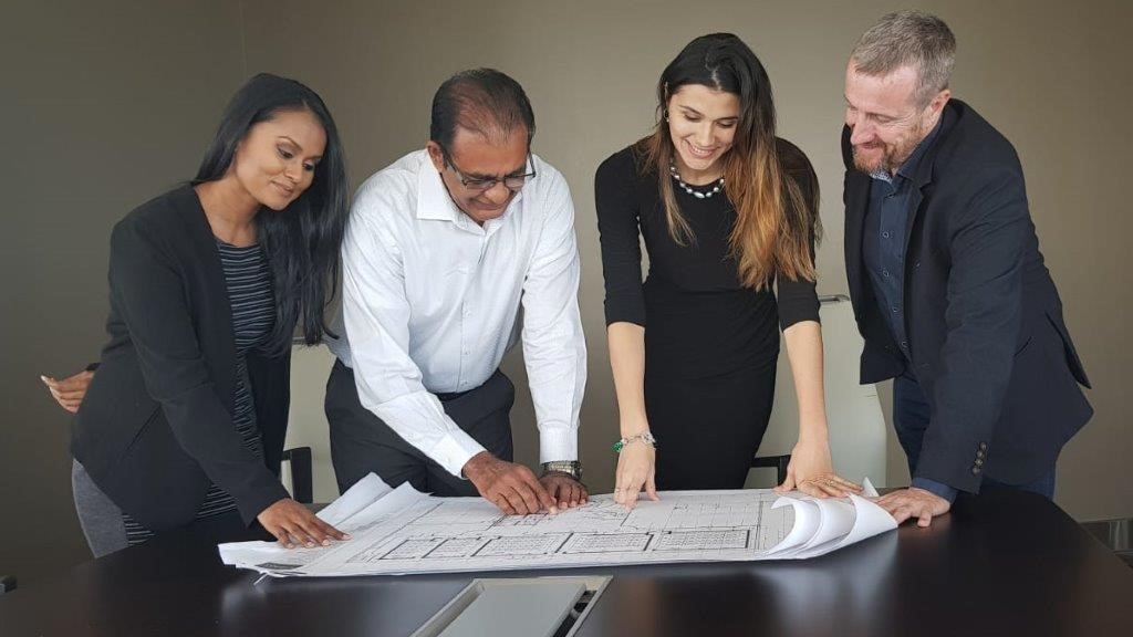 (From left to right) Reviewing plans for Gulf City: Ariana Parma- Area Sales Manager- Regus Trinidad & Tobago, Seunarine Samook- Managing Director-  Gulf City Mall, Stephanie Quesnel- General Manager- Regus Trinidad & Tobago, Mark Linehan- Managing Director- Regus Caribbean.