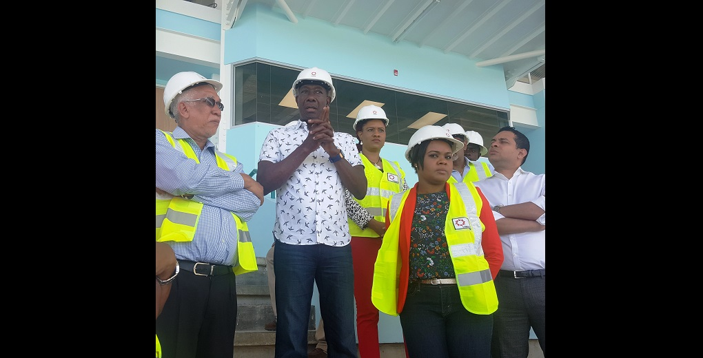 Prime Minister Dr Keith Rowley and UDECOTT Chairman Noel Garcia, discuss the work plan for the Dwight Yorke Stadium.