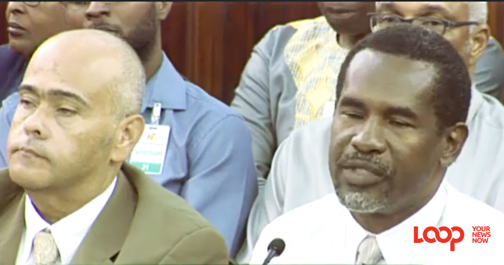 (right) Chief Licensing Officer (Ag.) Virgil Knight alongside the Minister of Transport, Works and Maintenance, Dr. William Duguid in parliament recently.