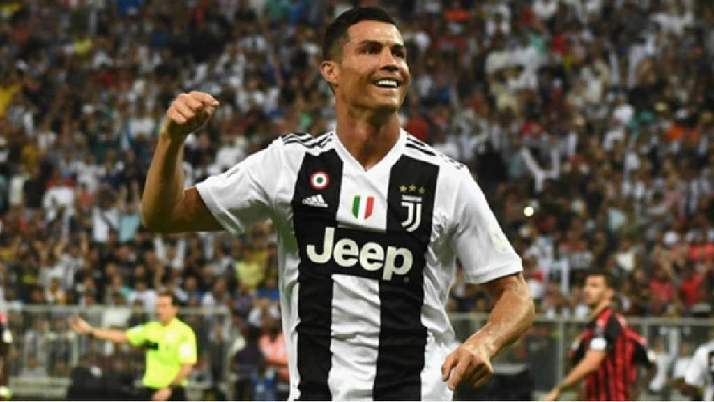 Cristiano Ronaldo celebrates against AC Milan.