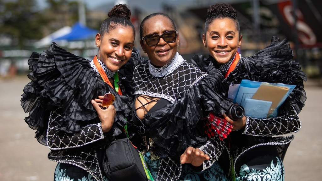 The ladies of K2K, Kathy and Karen Norman with their mum Althea on Carnival Tuesday at the Savannah. Photo courtesy Maria Nunes.