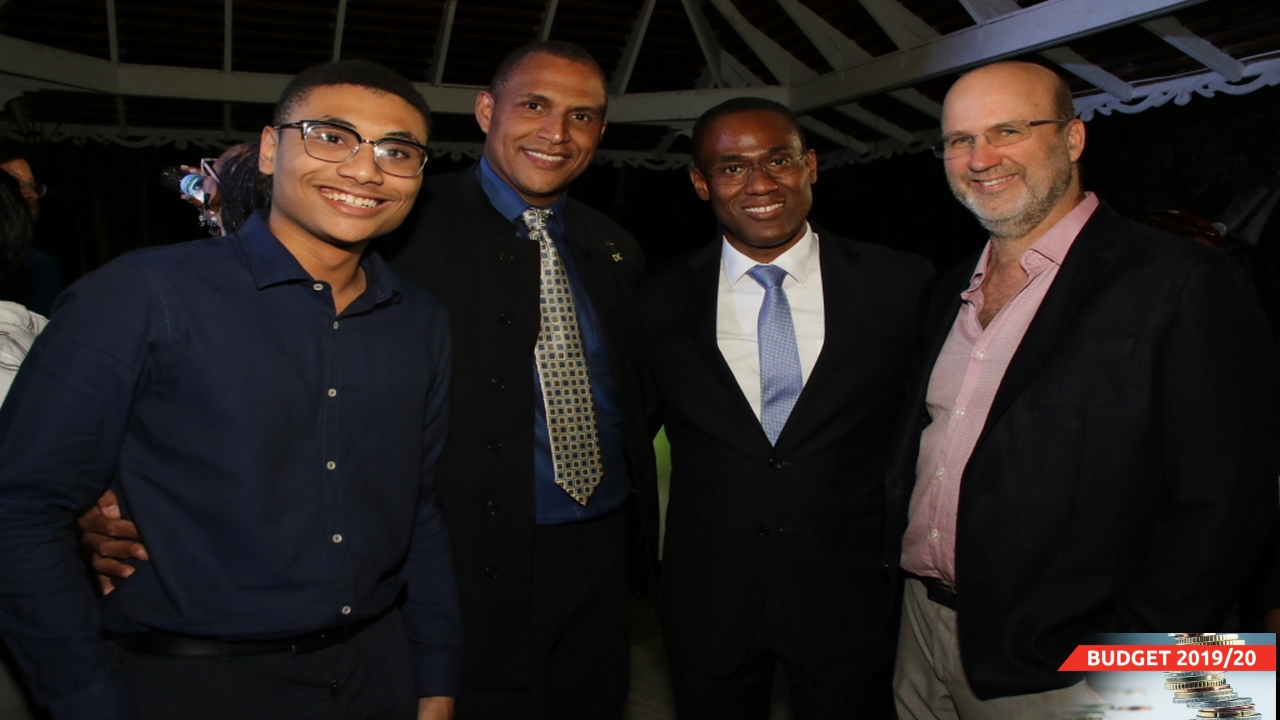 Finance Minister Nigel Clarke (second right) with (from left) Alexander Panton and his father David; and businessman PB Scott. (PHOTOS: Llewellyn Wynter)