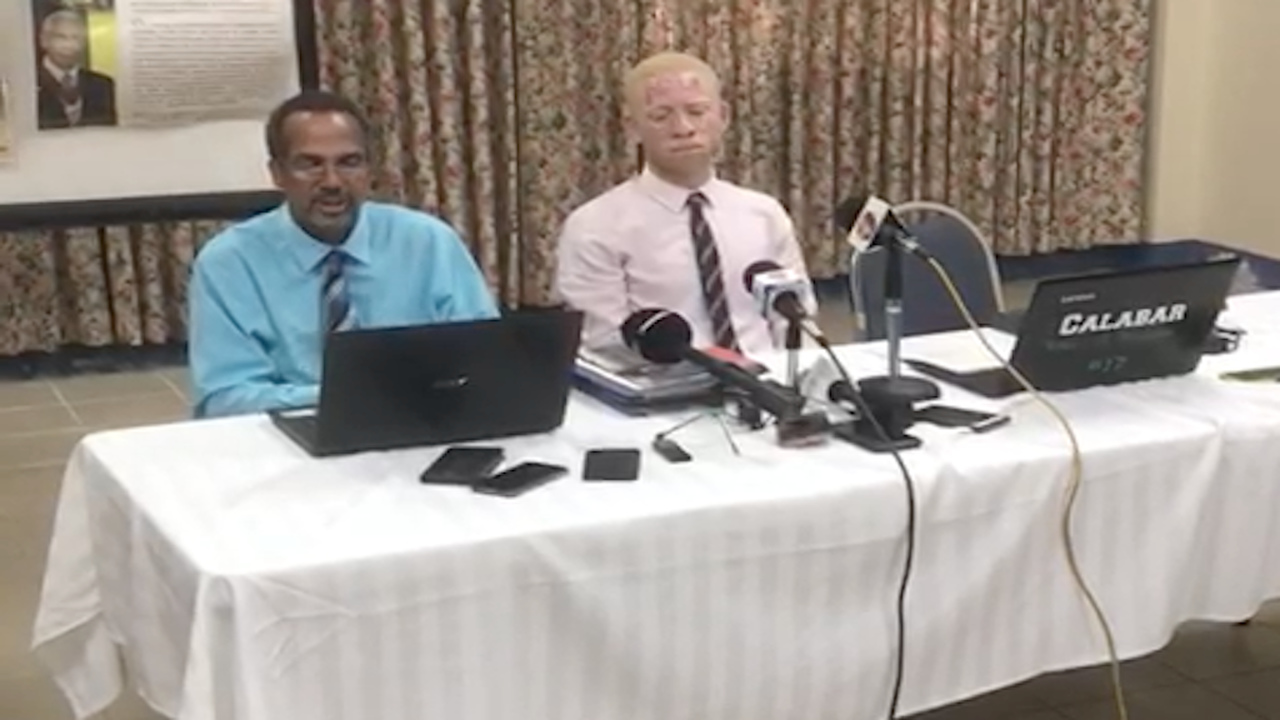 Former Calabar head boy David Fitz Henley (left) addresses journalists. Seated next to him is Sanjaye Shaw, the physics teacher who was allegedly attacked by two star athletes of the school.