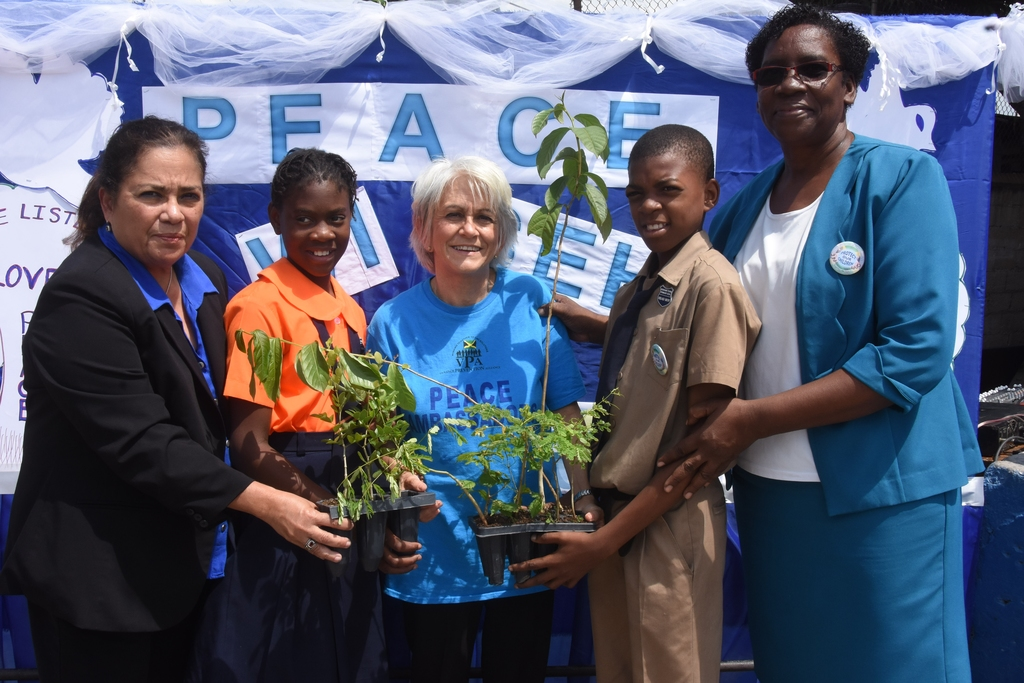 Peace Day activities held at Denham Town Primary School last year. From left are: Janilee Abrikian, general manager of PALS; Akelia Thompson,  a student at the school; Elizabeth Ward, chair of the VPA;Joshua Jeffrey, student and Eugenie Brown, principal of the school. They were engaged in tree planting activities.