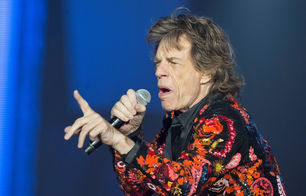 n this Oct. 22, 2017 file photo, Mick Jagger of the Rolling Stones performs during the concert of their 'No Filter' Europe Tour 2017 at U Arena in Nanterre, outside Paris, France. The Rolling Stones are postponing their latest tour so Jagger can receive medical treatment. (AP Photo/Michel Euler, File)