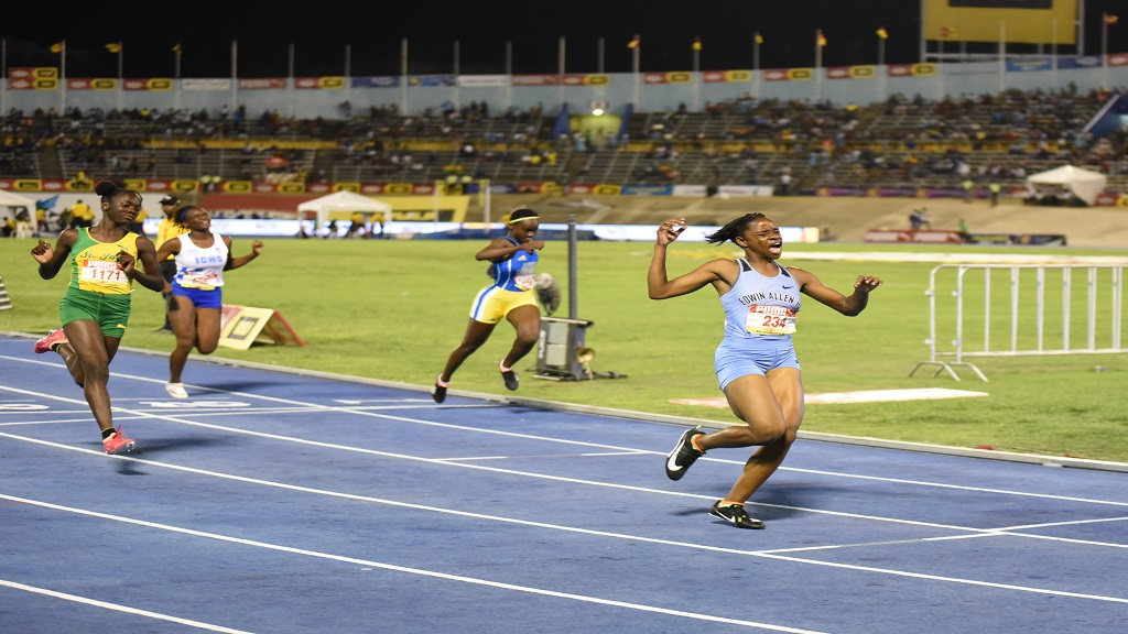 Tina Clayton of Edwin Allen High wins the Girls' Class 3 100m final at the ISSA/GraceKennedy Boys' and Girls' Athletics Championships at the National Stadium on Friday, March 29, 2019.