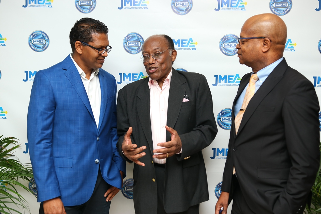 Donovan Wignal (r) President of the Micro Small and Medium Enterprises (MSME) Alliance and Richard Pandohie, Deputy President of the Jamaica Manufacturers and Exporters Association (JMEA) (l) listen intently as Prof. the Hon. Errol Morrison (c), Professor of Biochemistry and Endocrinology explains medical research data during the JMEA/PSOJ Industry Breakfast recently.