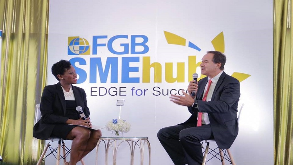 CEO of First Global Bank, Mariame McIntosh Robinson (left) and Hotelier Chris Issa during a fire side chat at the SME summit.