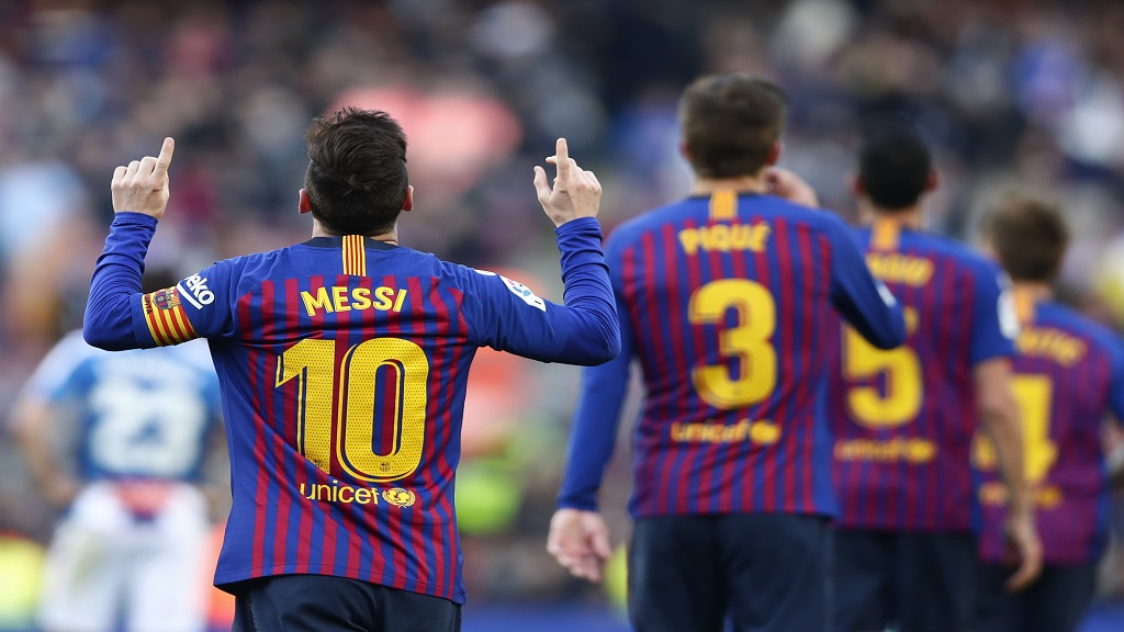 Barcelona's Lionel Messi, left, celebrates after scoring his side's second goal during a Spanish La Liga football match against Espanyol at the Camp Nou stadium in Barcelona, Spain, Saturday March 30, 2019.
