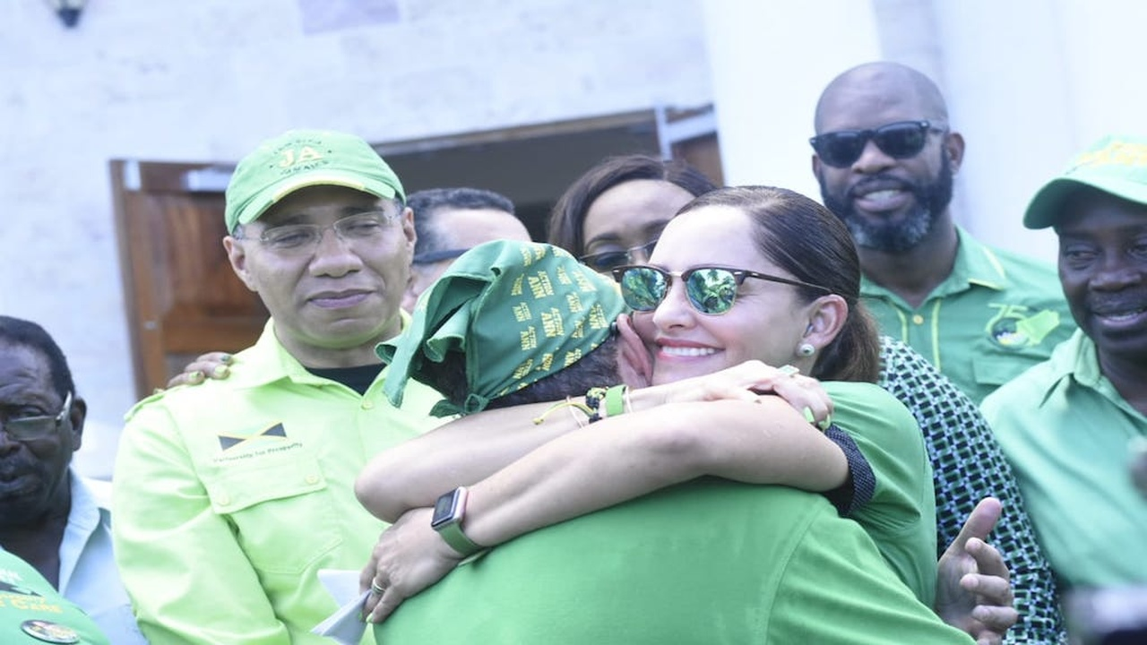 Ann-Marie and Daryl Vaz, in the company of Prime Minister Andrew Holness (left foreground)  and other Jamaica Labour Party (JLP) supporters,  share a warm embrace during her nomination for the April 4 East Portland by-election, at the Port Antonio Courthouse on Friday.