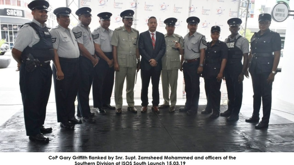 CoP Gary Griffith flanked by Snr Supt Zamsheed Mohammed and officers of the Southern Division at ISOS South Launch