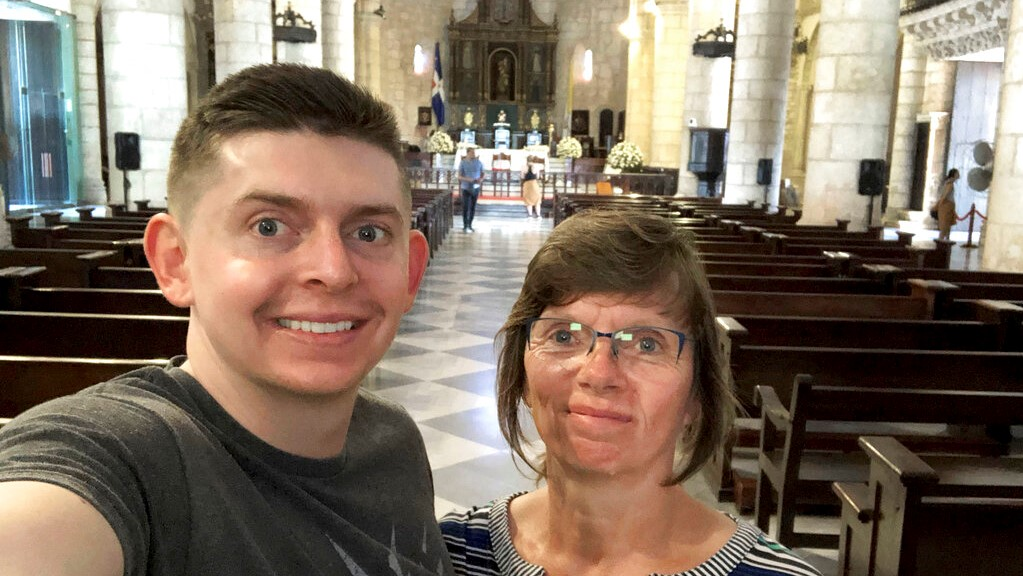 In this June 2018, selfie provided by Sherry Weddle, her son and journalist Cody Weddle and herself pose for a photo during a vacation in Santo Domingo, the Dominican Republic. (Courtesy Sherry Weddle via AP)
