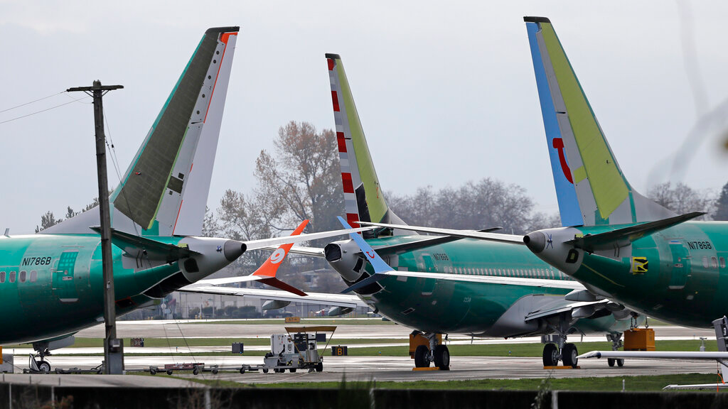In this Nov. 14, 2018, file photo Boeing 737 MAX 8 planes are parked near Boeing Co.'s 737 assembly facility in Renton, Wash. (AP Photo/Ted S. Warren, File)