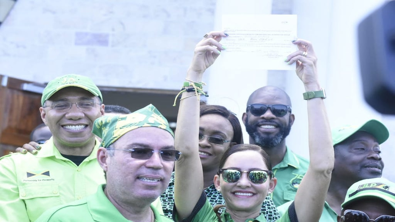 JLP candidate for East Portland, Ann Marie Vaz shows off her documents after being nominated on Friday. (PHOTO: Marlon Reid)
