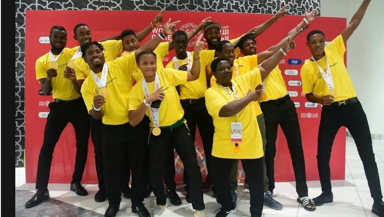 Members of Jamaica's team to the Special Olympics in Abu Dhabi show off the famous Usain Bolt pose.