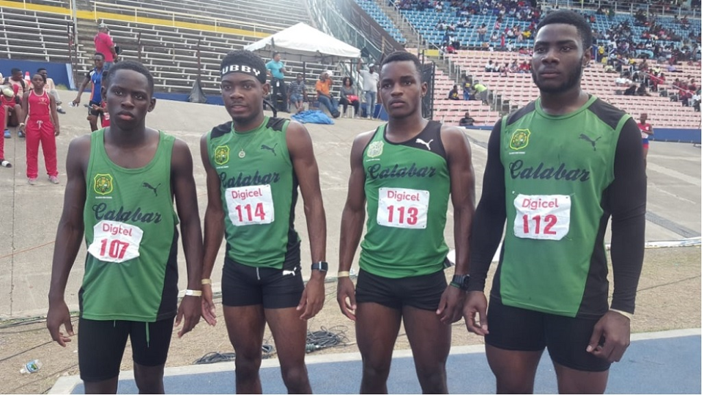 Christopher Taylor (2nd left) poses with teammates after competing at the Corporate Area Championship on March 9, 2019 at the National Stadium.