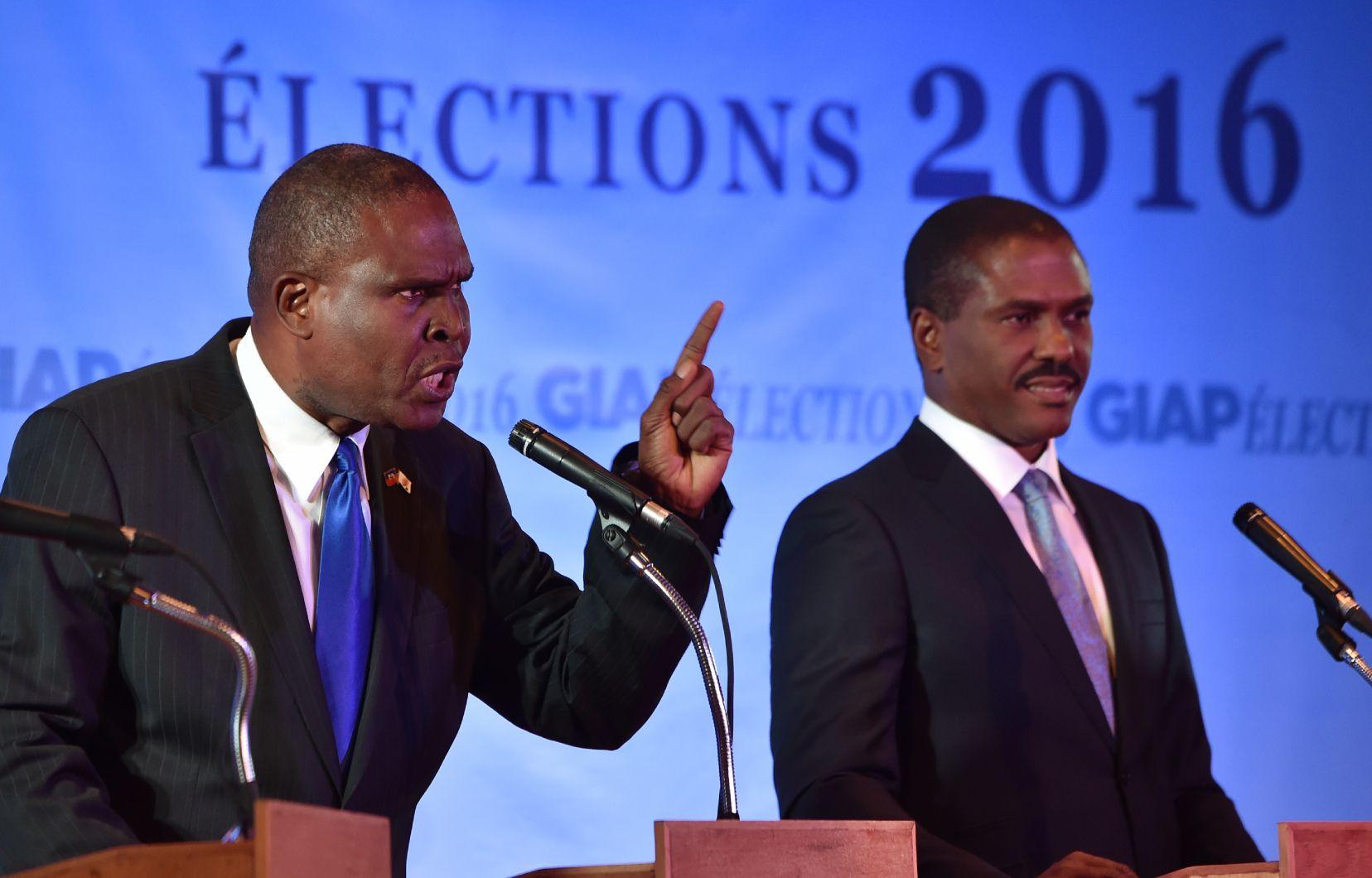 Photo: Hector Retamal Agence France-Presse Jean Henry Céant (à gauche) avait obtenu 0,75 % des suffrages à l'élection présidentielle de 2016.