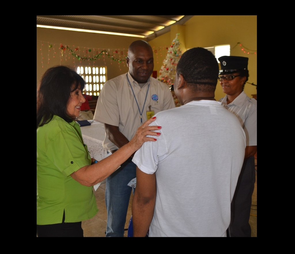 Food For The Poor-Jamaica Prison Ministry Administrator, Sandra Ramsey (left) and Housing Manager, Lorenzo Stanton give a final word of advice to an inmate of the St. Catherine Adult Correctional Centre, whose outstanding fine was paid by the charity in December 2018, thus securing his release from the penal institution.