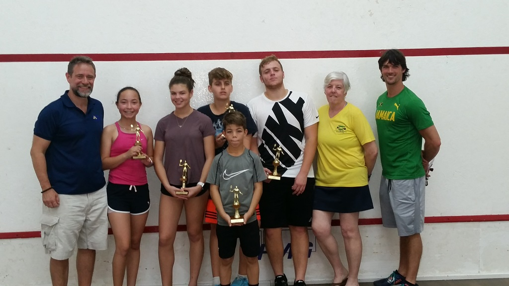 Newly crowned age group champions display their trophies after the awards ceremony of the 2019 All Jamaica Junior Squash Championships  at the Liguanea Club in New Kingston from March 14 – 16, 2019.