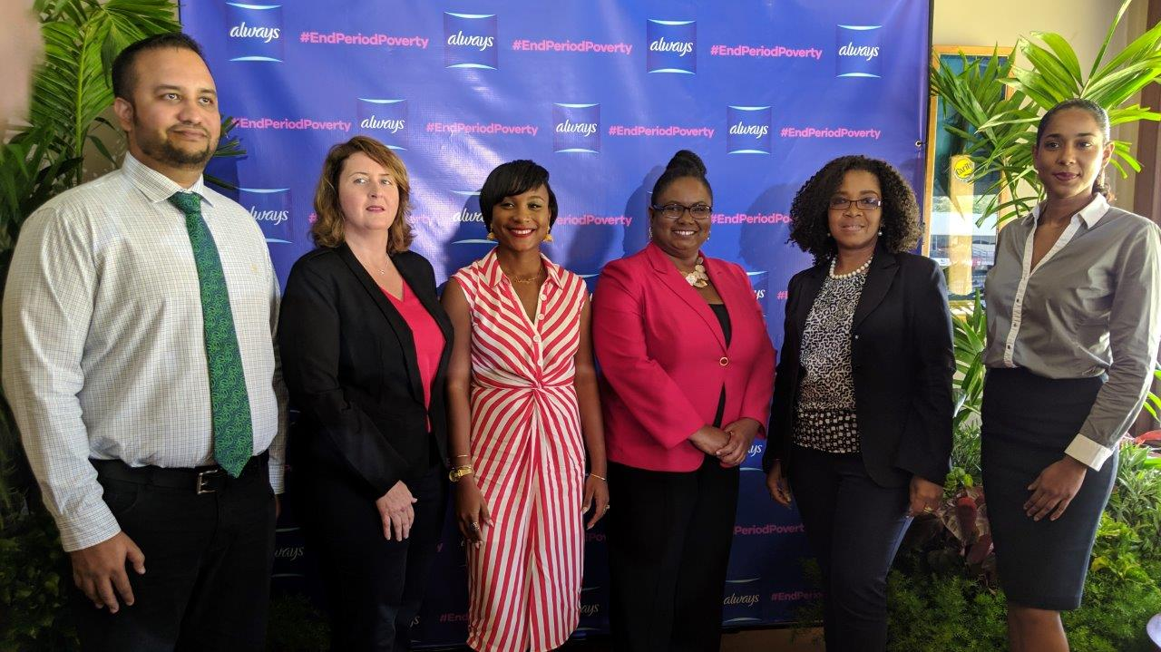 Left to right: Kevan Maharaj, Business Unit Head - Proctor & Gamble, Donella DeVerteuil, Market Manager - Proctor & Gamble, Whitney Husbands, Simone Hayes Noel, School Supervisor III, POS Education District, Jill De Bourg, General Manager - KIND, Samantha Duncan, President - Helping Her Foundation