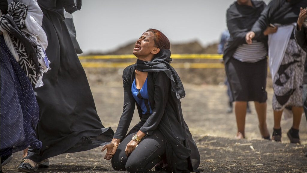 Ethiopian relatives of crash victims mourn and grieve at the scene where the Ethiopian Airlines Boeing 737 Max 8 crashed shortly after takeoff on Sunday killing all 157 on board, near Bishoftu, south-east of Addis Ababa, in Ethiopia Thursday, March 14, 2019.  (AP Photo/Mulugeta Ayene)