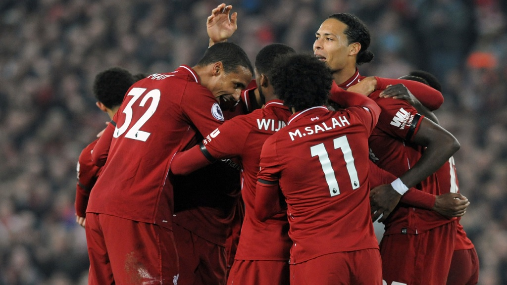 Liverpool's Divock Origi celebrates with teammates after scoring his side's third goal during the English Premier League football match against Watford at Anfield stadium in Liverpool, England, Wednesday, Feb. 27, 2019.