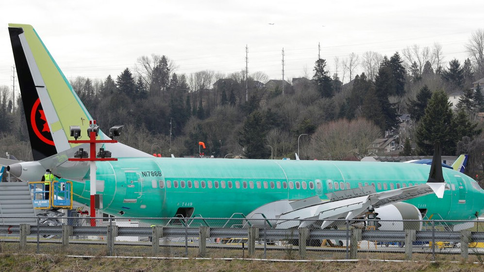 In this photo taken Monday, March 11, 2019, a Boeing 737 MAX 8 airplane being built for Air Canada sits parked at Boeing Co.'s Renton Assembly Plant in Renton, Wash. (AP Photo/Ted S. Warren)