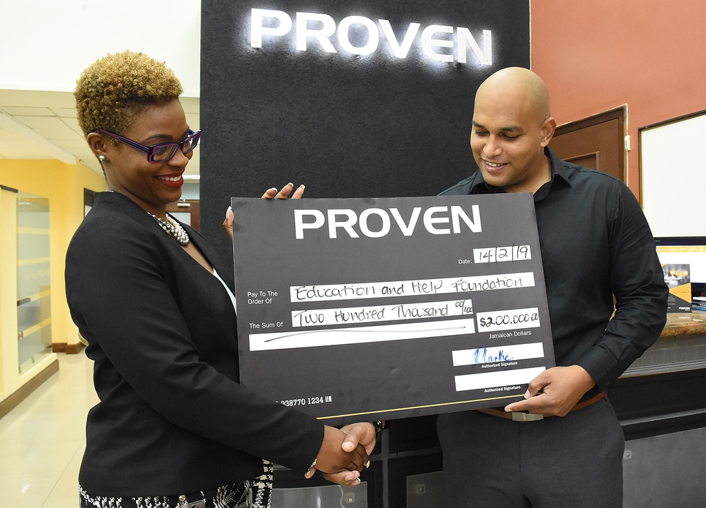 Caption: [left to right] Trecia-Gay Clarke Head of Pensions Administration, PROVEN Fund Managers Ltd and Darren Virtue COO of the Education and Help Foundation seal the donation of $200,000 with a handshake.
