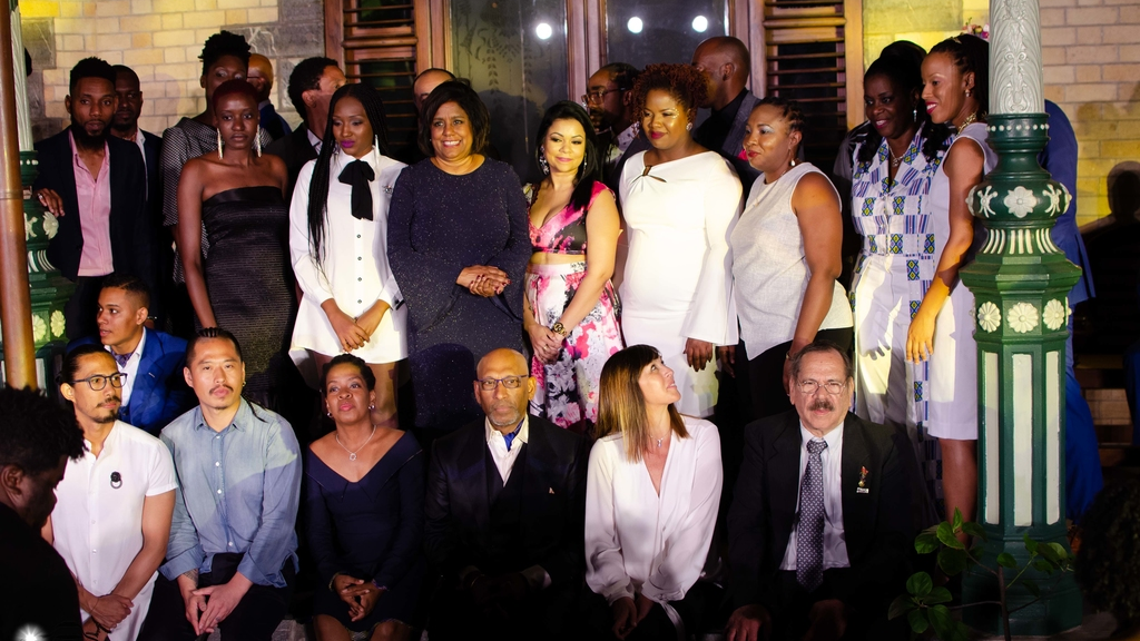 Minister of Trade and Industry Senator the Hon. Ms. Paula Gopee-Scoon, and General Manager FashionTT, Lisa-Marie Daniel among the Savile Row Academy of Trinidad and Tobago tailors.