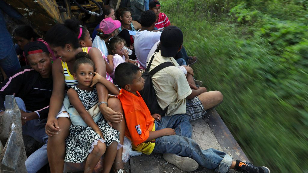 Central American migrants, part of the caravan hoping to reach the U.S. border, travel on a truck in Loma Bonita, Oaxaca state, Mexico, Saturday, Nov. 3, 2018. (AP Photo/Rodrigo Abd)