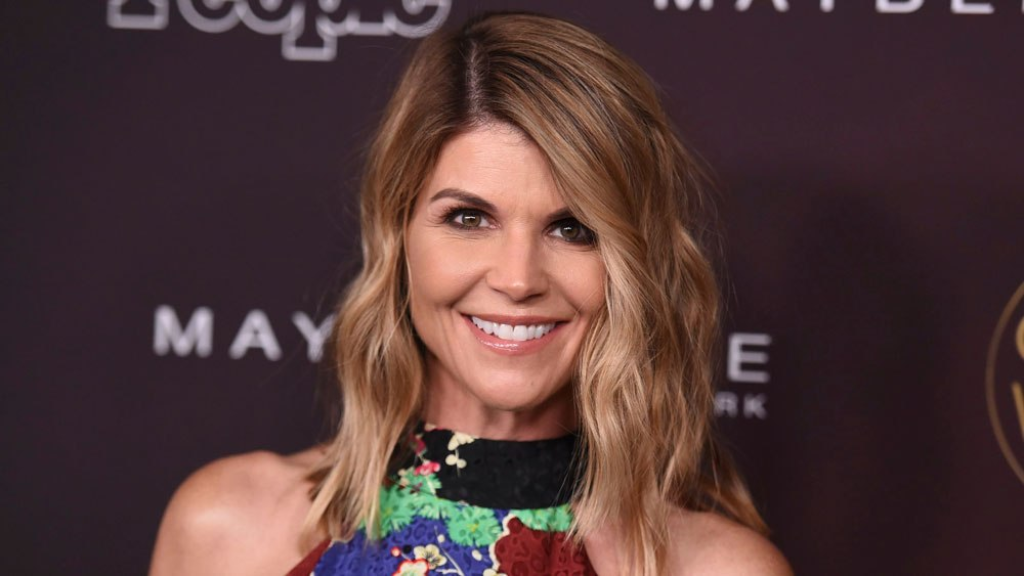 "FILE - In this Oct. 4, 2017 file photo, actress Lori Loughlin arrives at the 5th annual People Magazine ""Ones To Watch"" party in Los Angeles. (Photo by Richard Shotwell/Invision/AP, File)"
