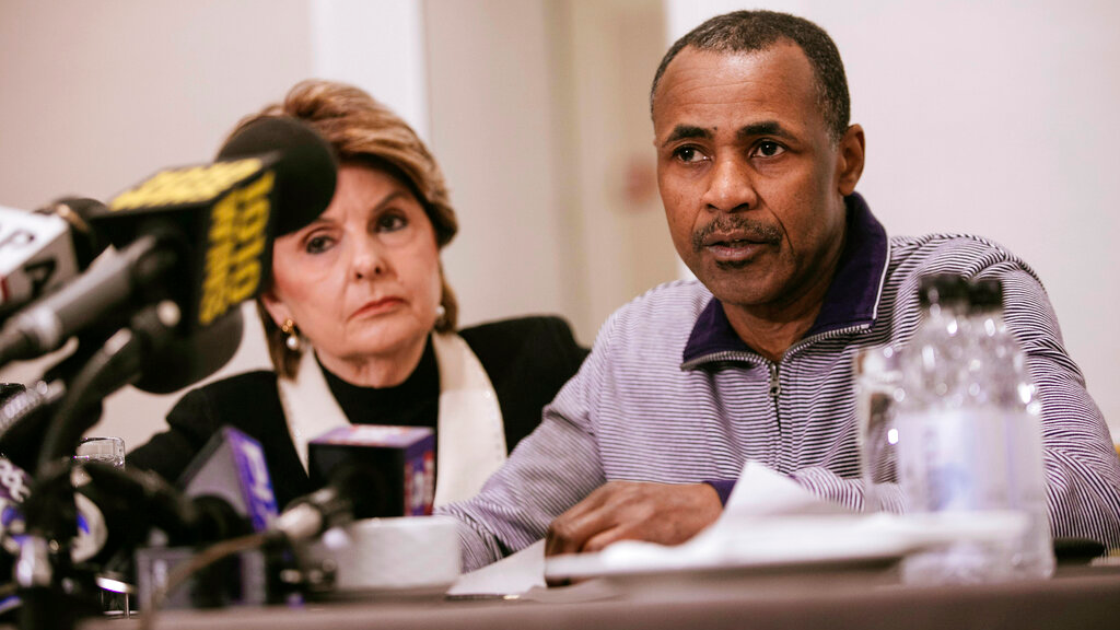Gary Dennis, seated with Lawyer Gloria Allred, speaks during a press conference announcing a video tape said to present further evidence of wrongdoing by recording artist R. Kelly Sunday, March 10, 2019, in New York. Dennis said the tape, which he found at his home in Pennsylvania, shows R. Kelly sexually abusing more than one underage girl. (AP Photo/Kevin Hagen)