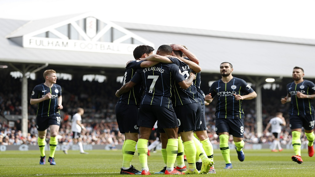 Manchester City players celebrate after Bernardo Silva scored the opening goal during the English Premier League football match against Fulham at Craven Cottage stadium in London, Saturday, March 30, 2019.