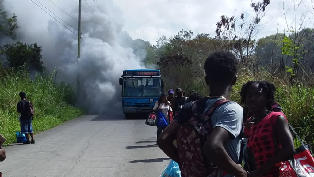 Smoke seen coming from the bus en route to St. Andrew.